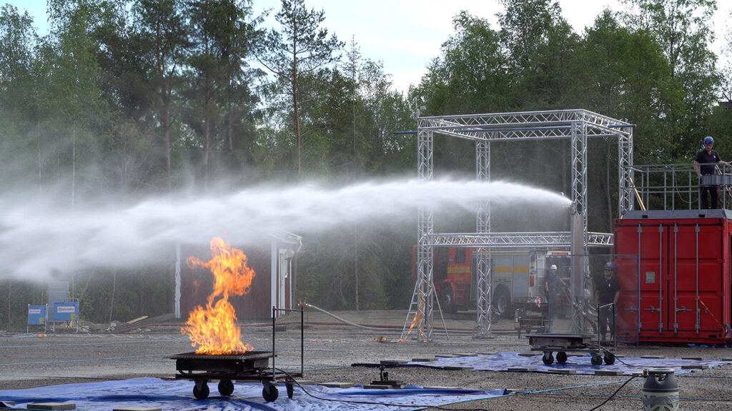 """The water cannon automatically aims the water eerily like a human fire fighter would with a joystick. When the fire is out, the system automatically shuts off the water, but remains ready to react again if any new flames are detected.  The system is designed to operate 24/7/365, and typically sprays water onto the fire within about ten seconds from a fire breaking out.  The system uses high-tech flame detectors and electronic hardware and software to locate the fire and aim the water cannons. The system is updated 10 times per second.  According to Unifire spokesman, Roger Barrett James, """"Unifire developed the FlameRanger system for rapid, fully automatic fire fighting in relatively large open areas, such as waste and recycling plants, aircraft hangars, atriums, manufacturing facilities and warehouses, tunnels, building exteriors, on ships, etc. To our knowledge, it is the only automatic robotic nozzle fire fighting system in the world with real-time, three-dimensional aiming from flame detector data."""""""